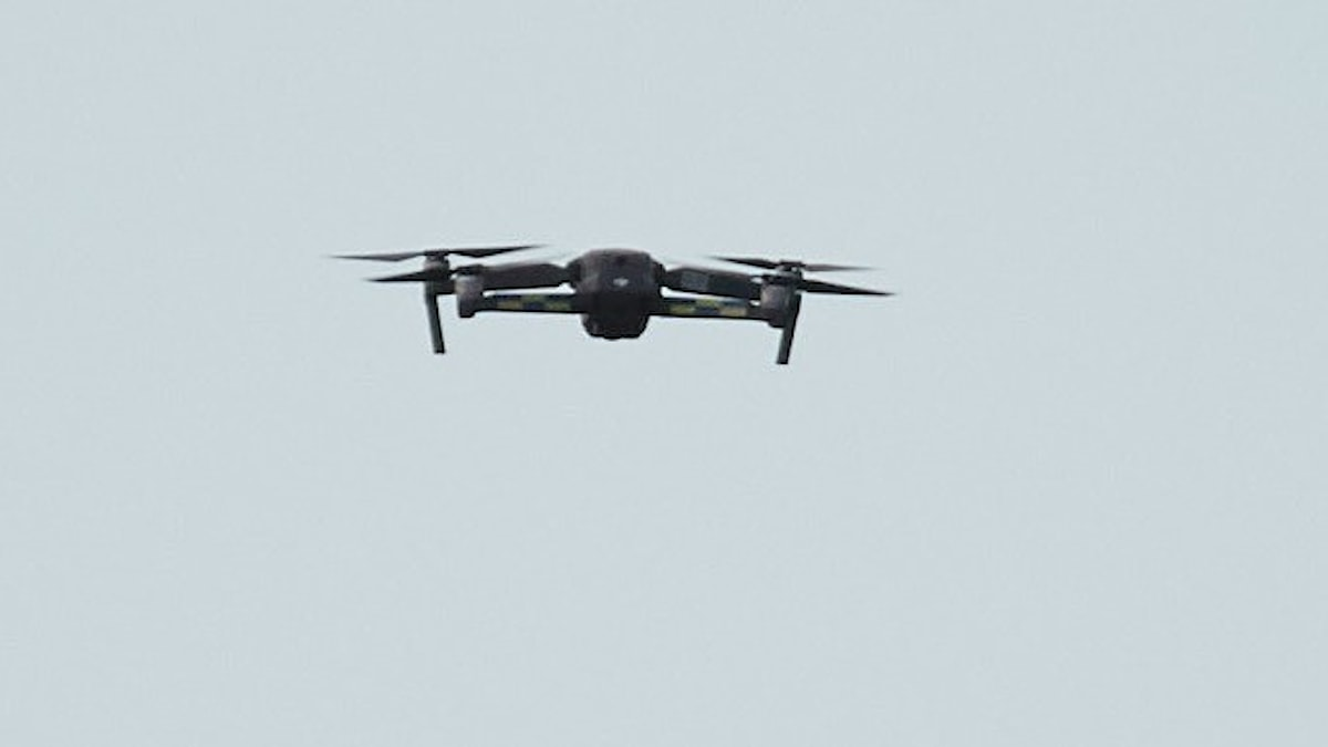 A flying drone in the sky