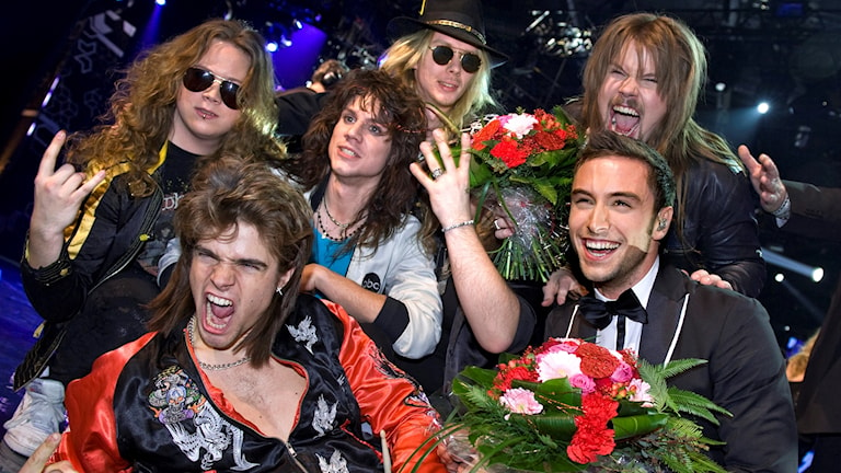 Måns Zelmerlöw and the band H.E.A.T celebrate their victory