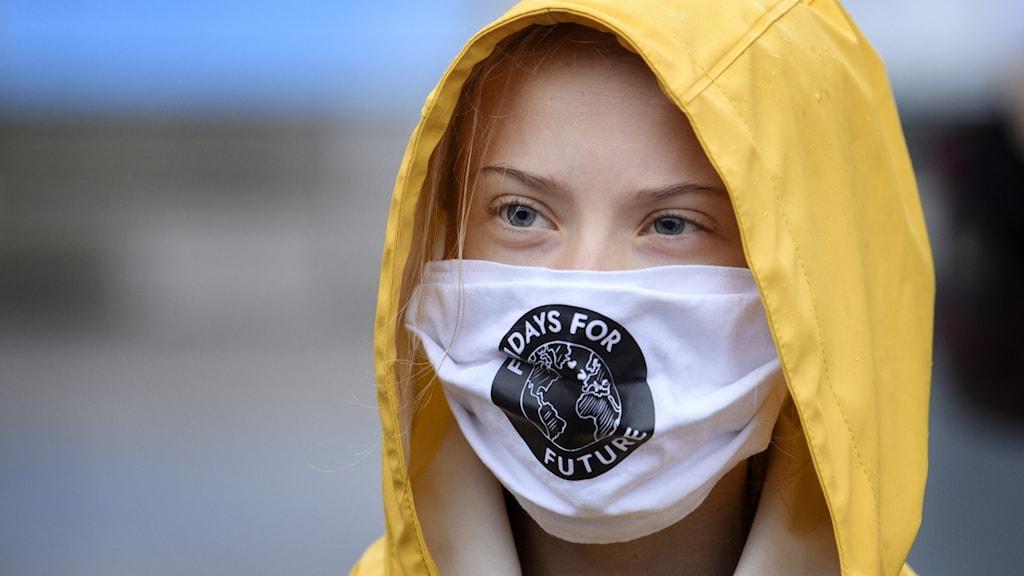 Greta Thunberg wearing a protective mask.