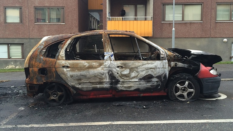 A burnt-out car in the Stockholm surburb of Fittja.
