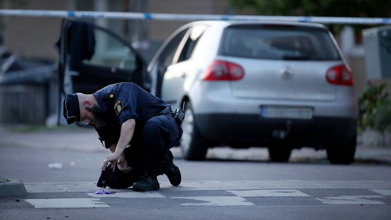 Police officer securing evidence on the streets of Gothenburg