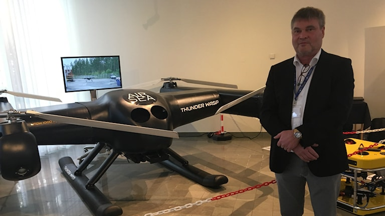 Claes Drougge, CEO of the ACC Group, standing in front of Thunderwasp and Sea Drone.