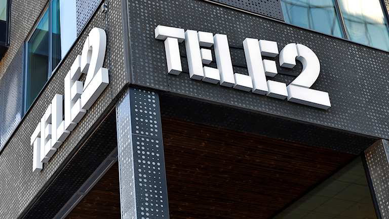 A sign for Tele2 on the side of a building.