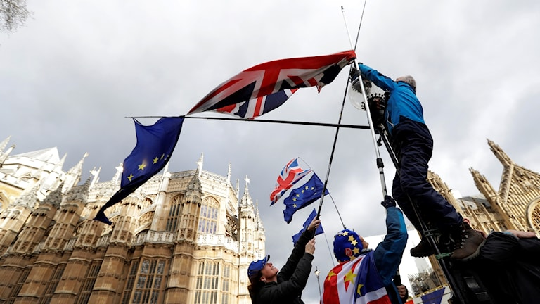 British and European flags waved by a protester outside the Houses of Parliament.