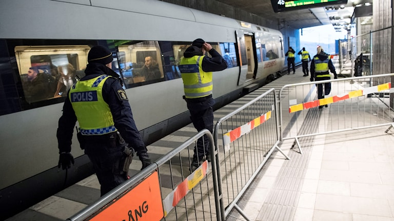 Police carry out passport checks on a train between Sweden and Denmark.