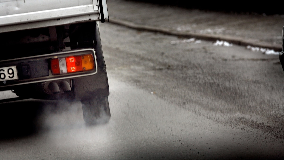 Close-up of the exhaust fumes coming from a truck.