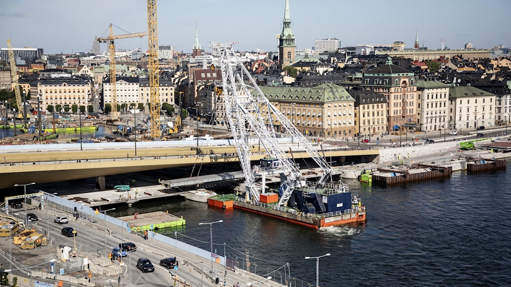 A picture of a boat approaching the new Slussen bridge.