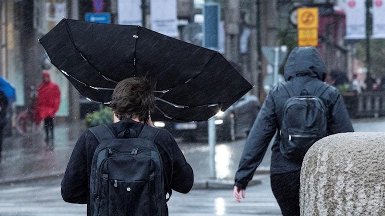 An umbrella blowing outward.