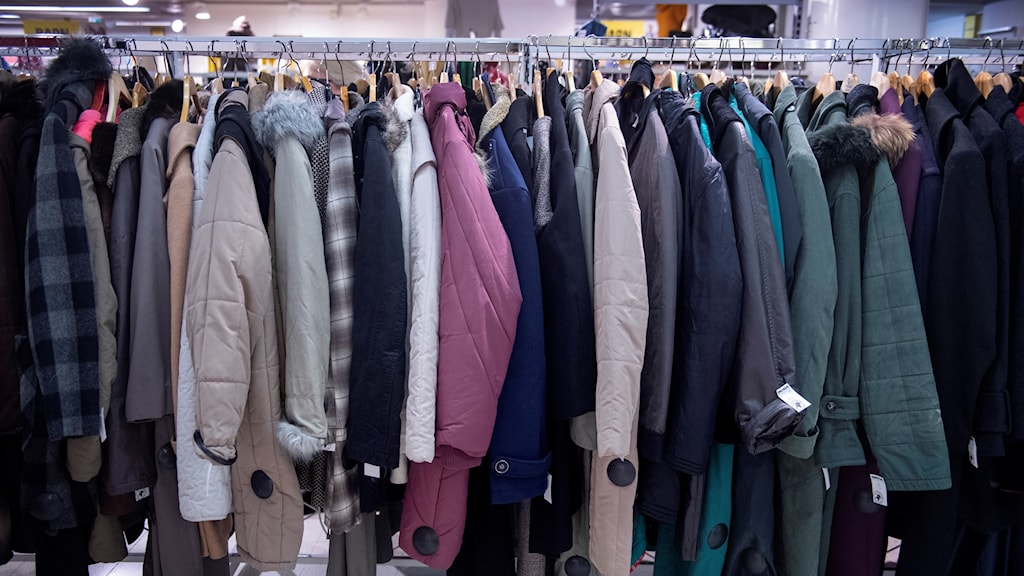 Coats hanging on a rack.