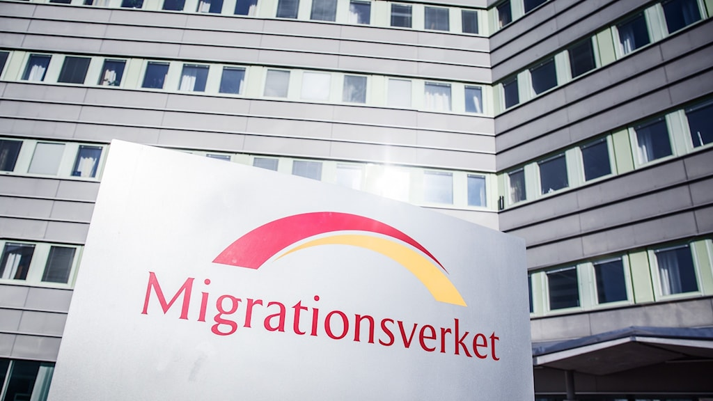 """a sign that reads """"Migrationsverket"""" in front of an office building."""