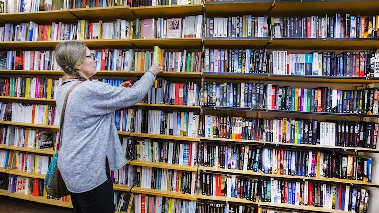 A shelf of books in a shop