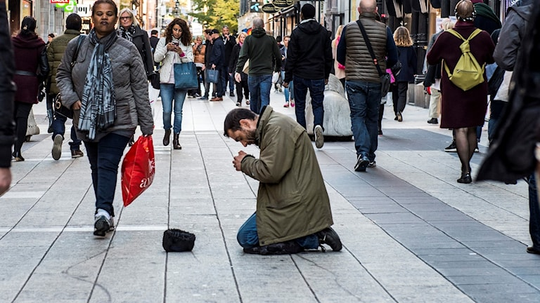 A beggar on the main shopping street in Stockholm