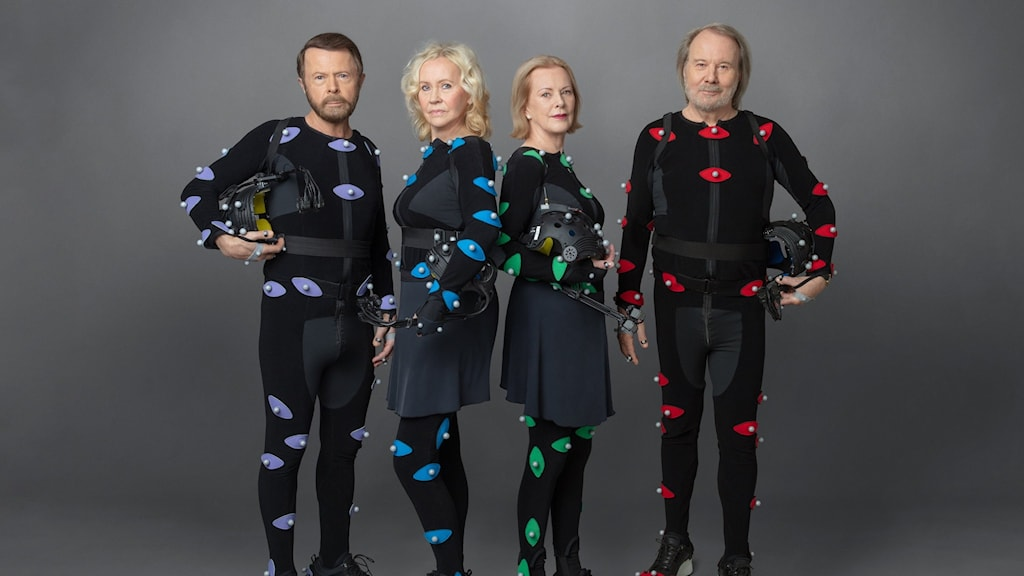 ABBA-band members in specially designed avatar suits (black with different coloured dots on them).