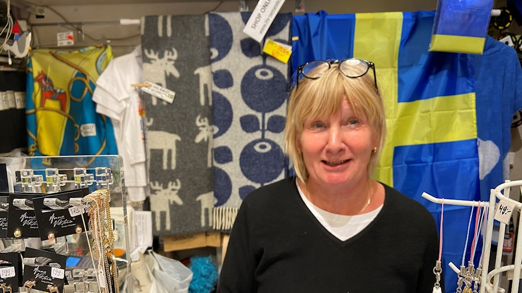 A woman in a souvenier shop.