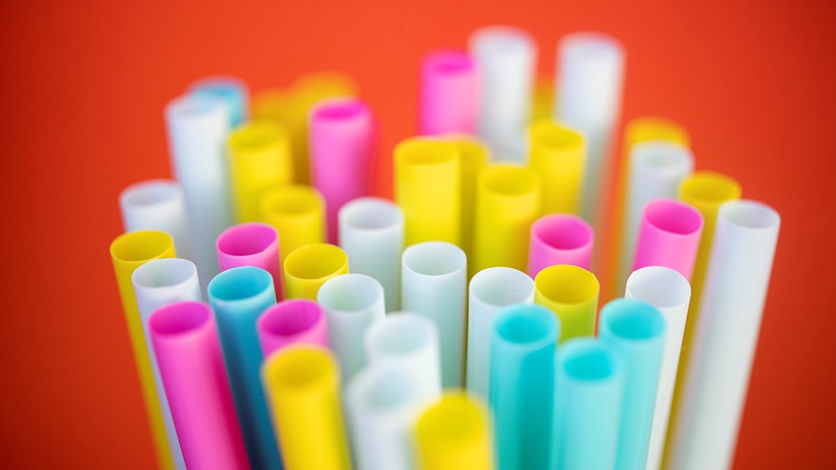 close up of colourful plastic straws.