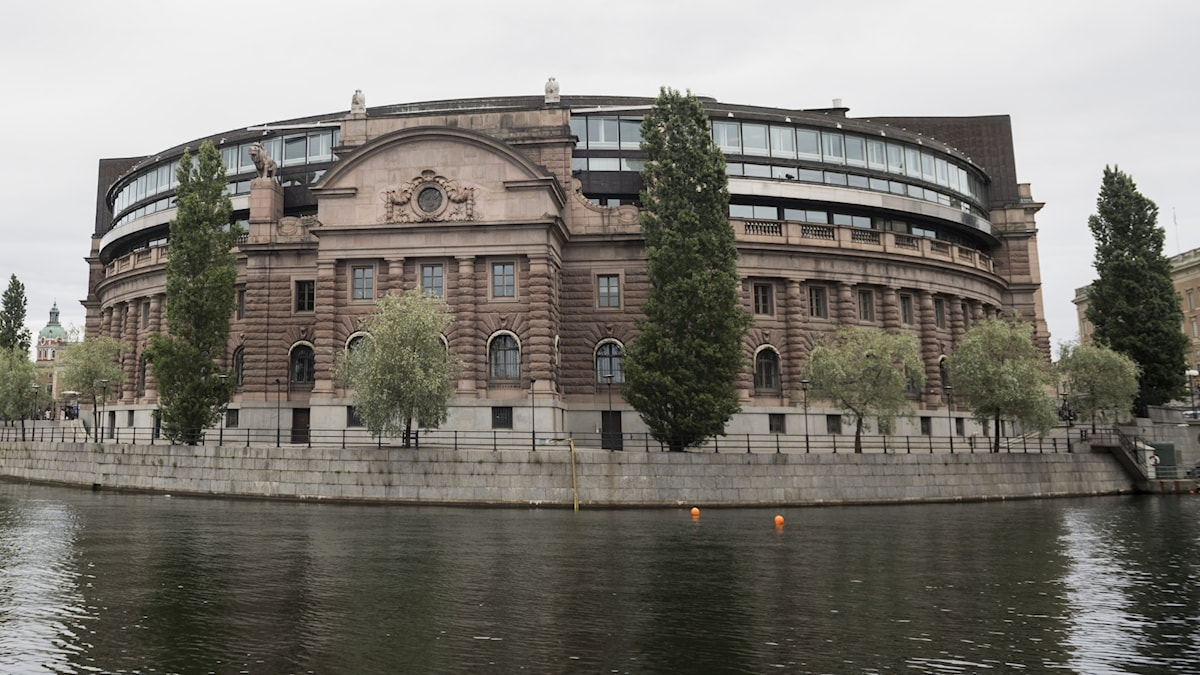 A stately building by the water.