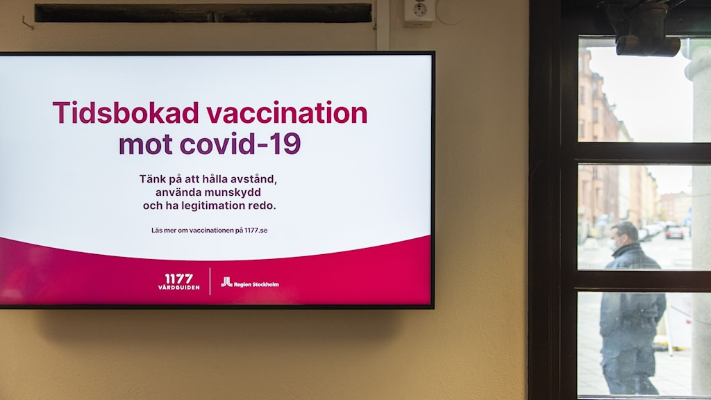 An image of a sign advertising booking for covid-19 vaccinations.