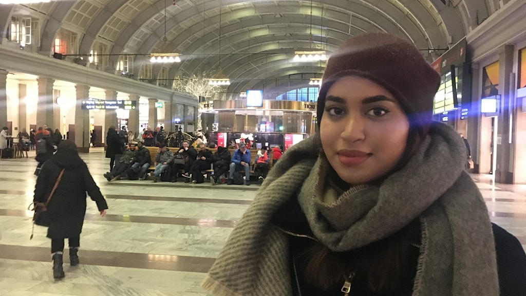 Woman in scarf and hat at Stockholm central stration.