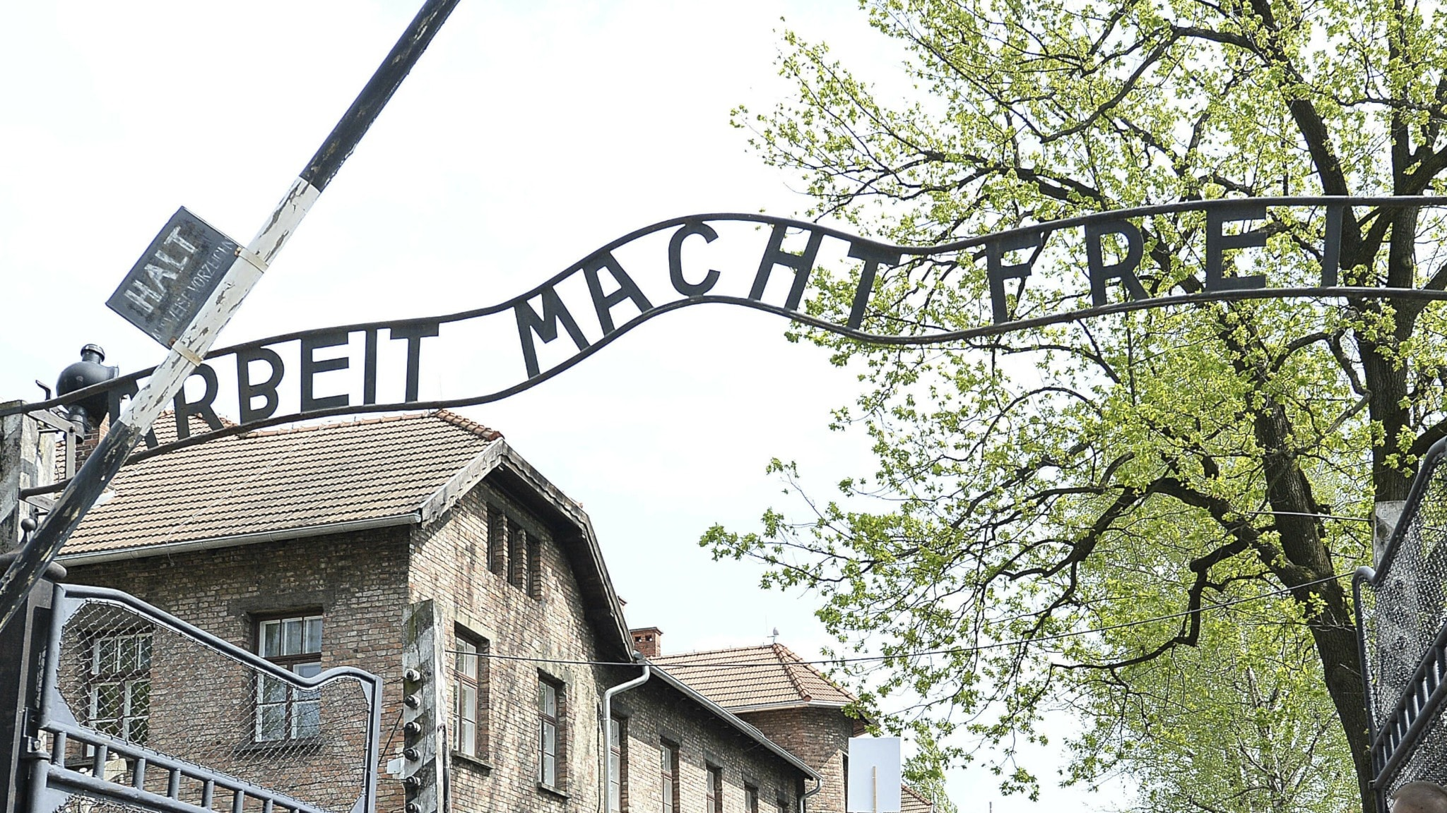 """The """"Arbeit Macht Frei"""" sign over the gate to the Auschwitz concentration camp."""