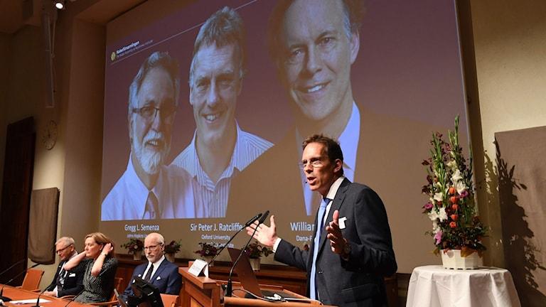 Announcing the Nobel winners.
