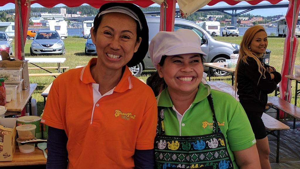 Araya Vestlund (left), owner of SuanThai takeway, with friend.
