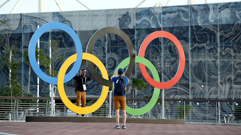 Tourists taking photos of the Olympic rings in Rio.