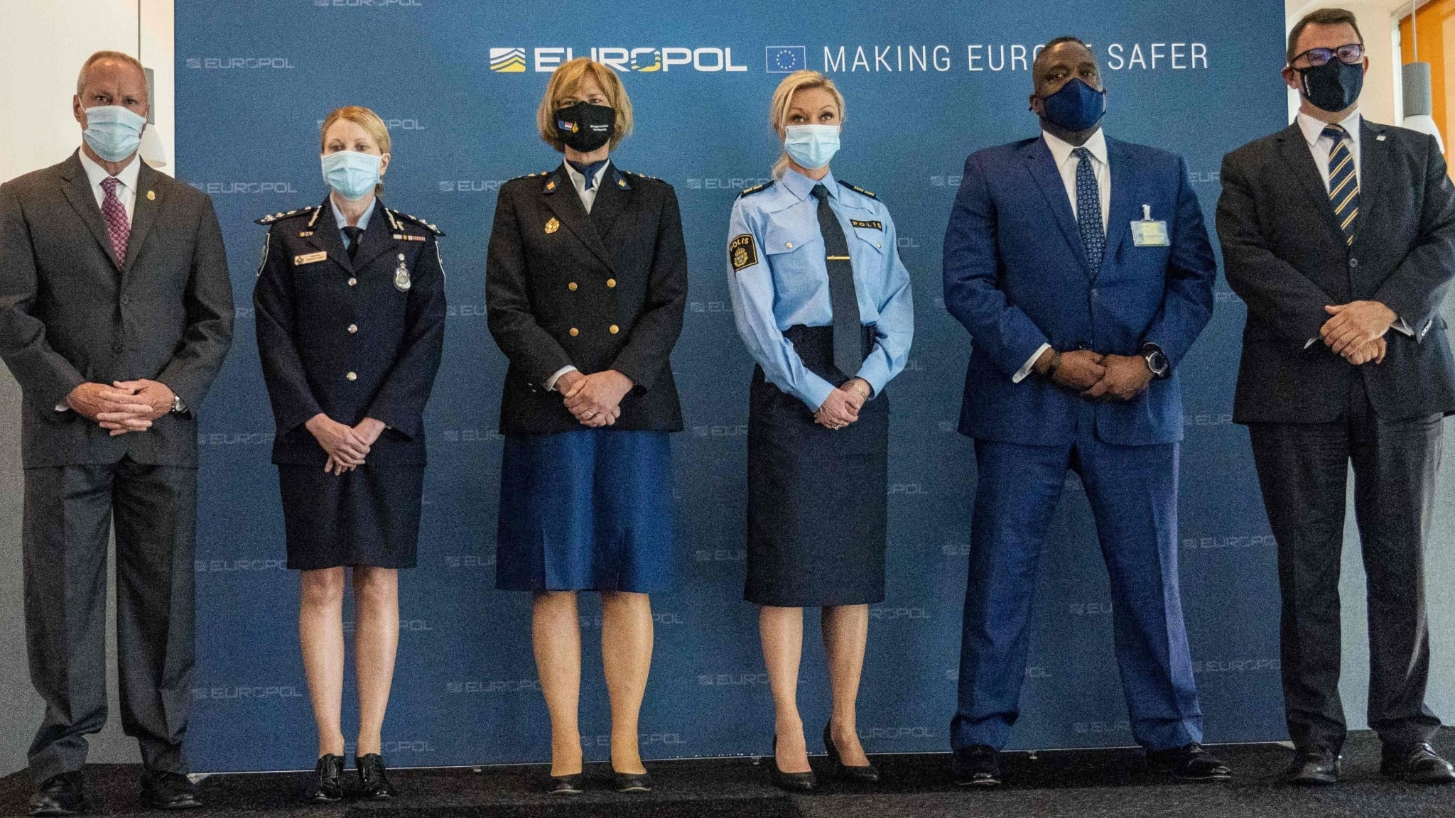 International group of police standing in a line