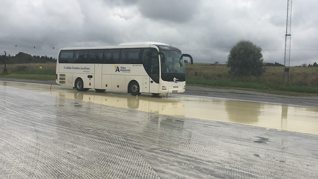 A bus doing an emergency stop on a wet surface