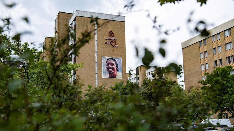 A picture of a housing area showing a huge poster of Zlatan