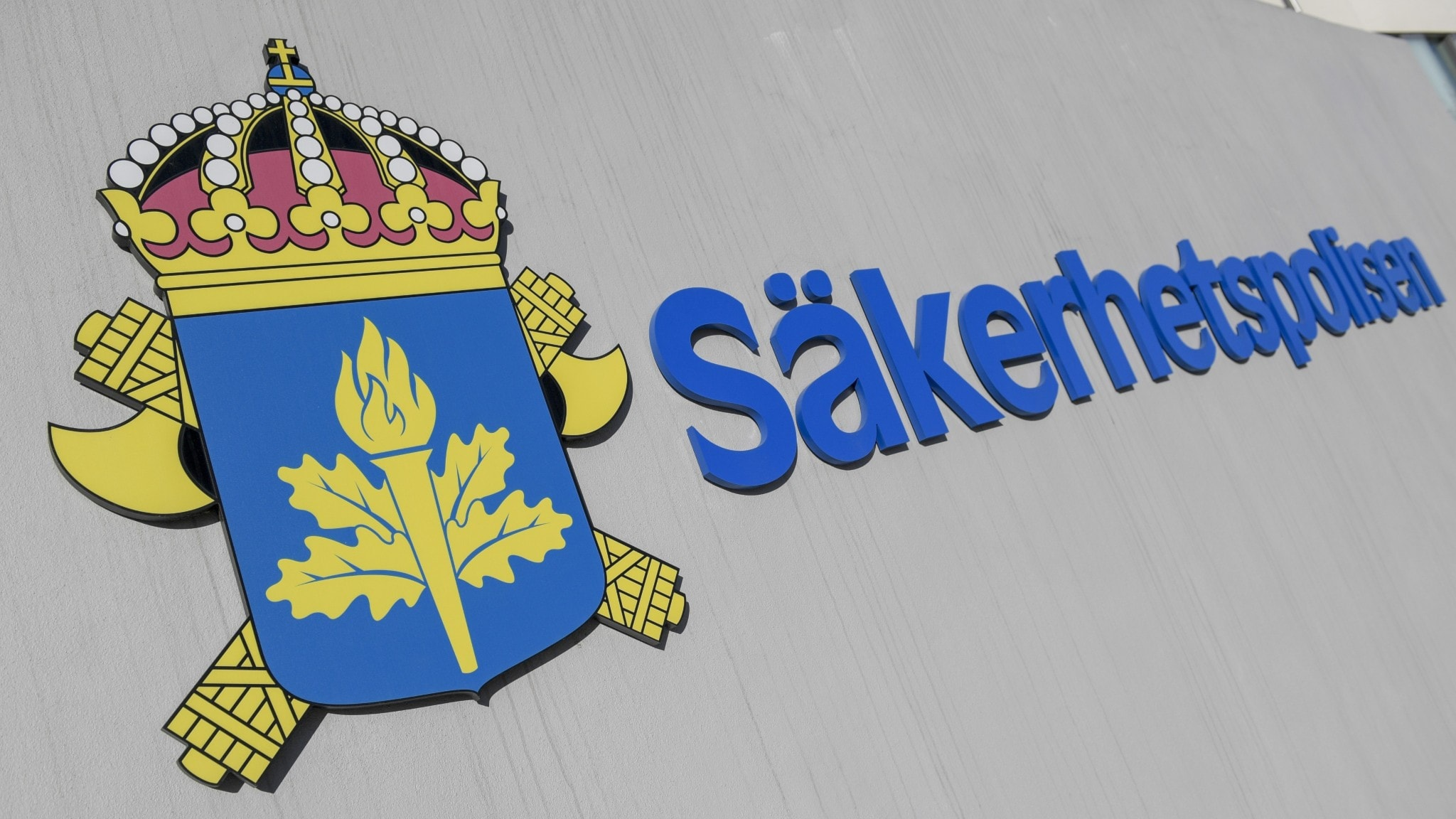 A sign showing the crest and logo of the security service