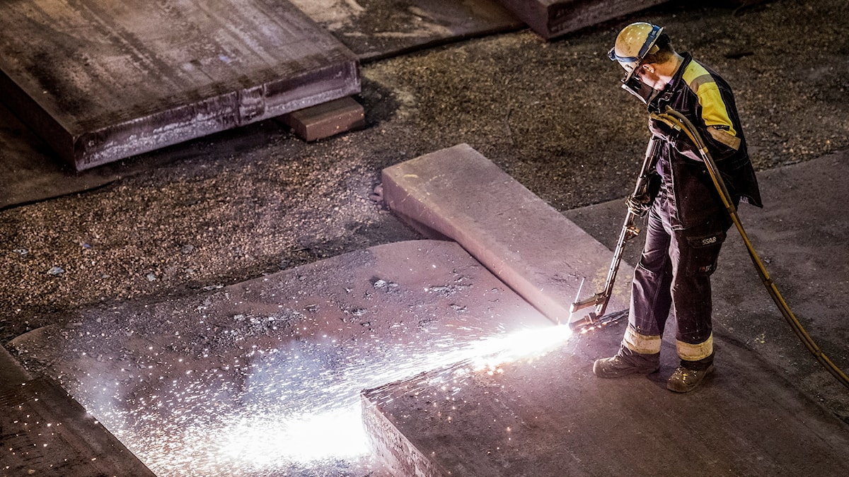 A man working on steel production