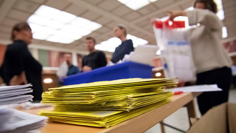 A pile of paper ballots
