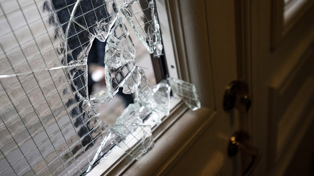 An image of a glass frame on a door that has been broken.