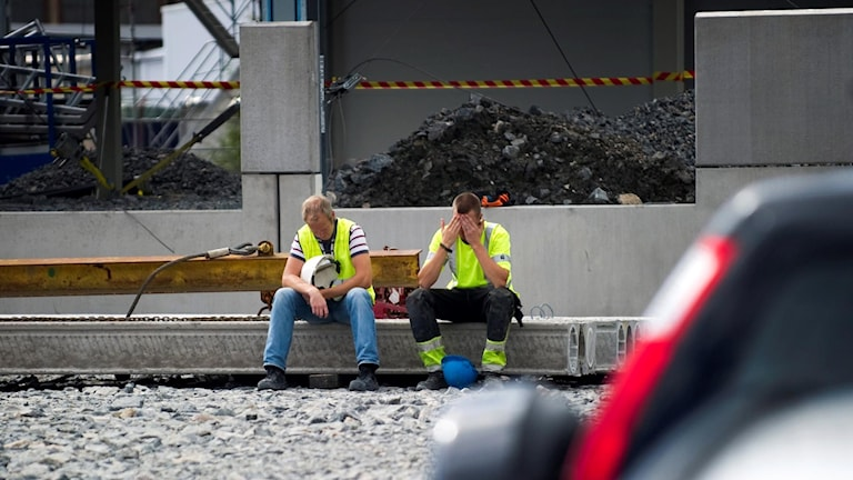 Two workers on a building site.