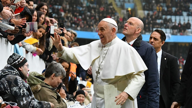 Pope Francis greeting members of the public.