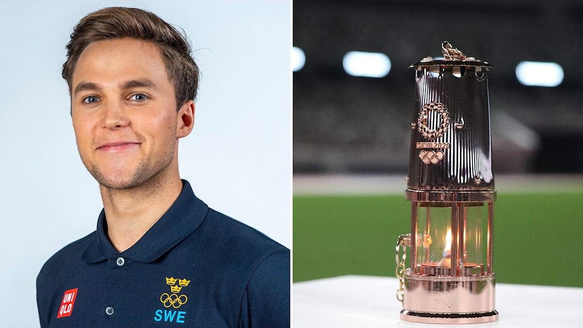 Picture of Hannes Puman and a lantern containing the Olympic flame in Tokyo.