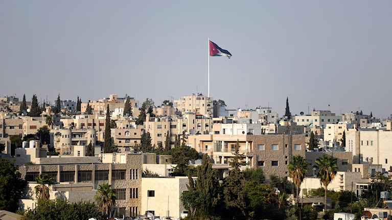 View of Amman with Jordian flag blowing.