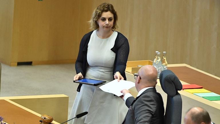 Sweden Democrat representative Paula Bieler hands over a call for a no-confidence vote on Prime Minister Löfven.