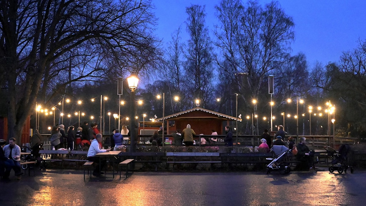 An outdoor seating area in Skansen at twilight.
