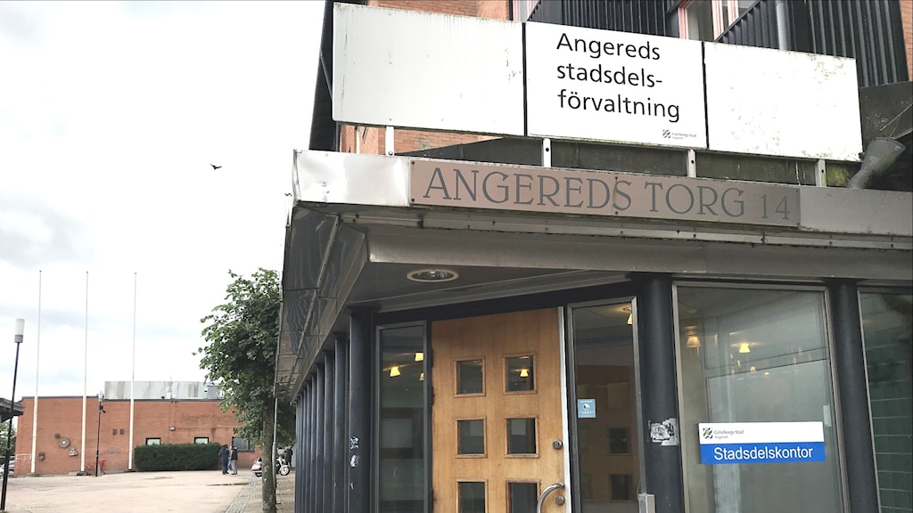An entrance way with a sign above it reading Angered's square in Swedish.