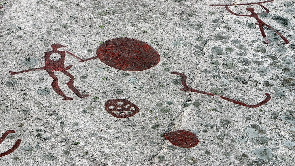 Just one of the rock carvings at Tanum depicting two men with spears, a viking boat.