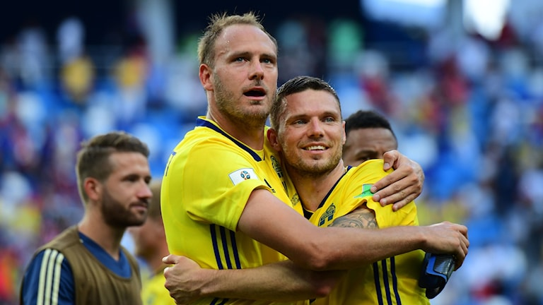 Two Swedish football players hugging