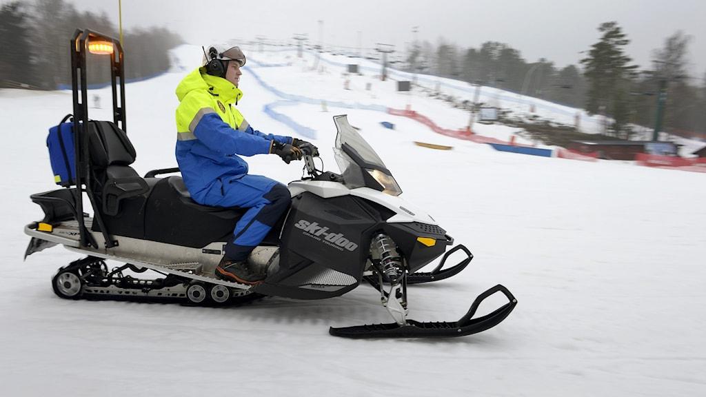 A snowmobile on a ski slope