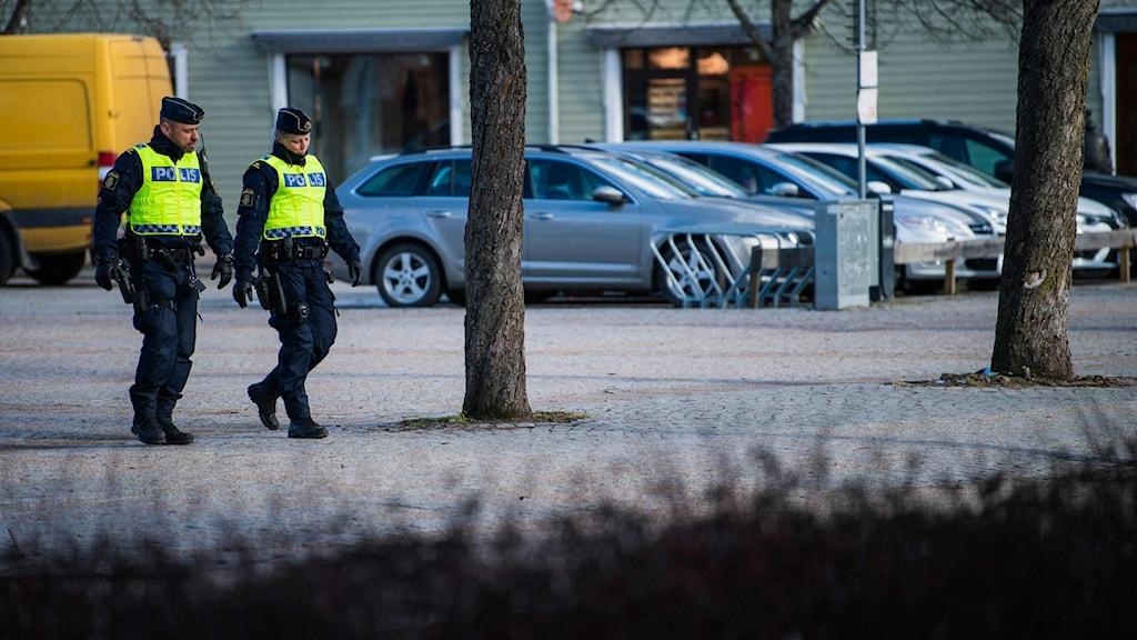 Two police officers walking in Vetlanda.