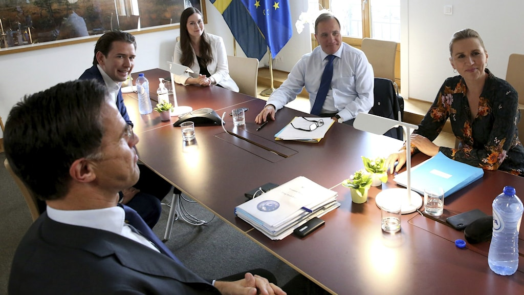 Stefan Löfven sitting at a table with other European leaders.