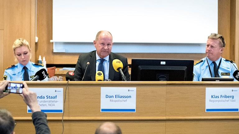 National Police Chief Dan Eliasson, center, at a news conference earlier this summer.