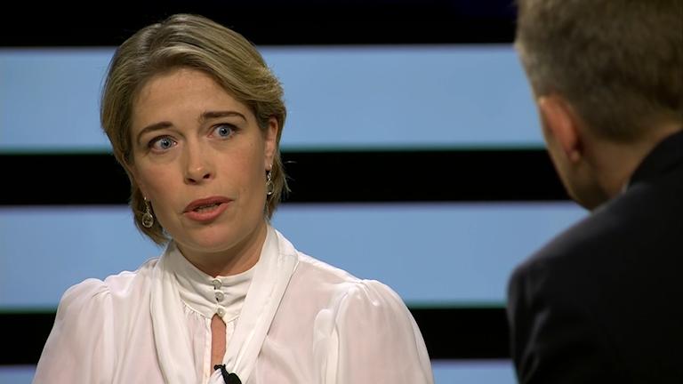 Minister Annika Strandhäll sitting on a TV stage.