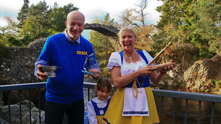 Ellinor Persson (right, beside her daughter) with her 'Golden Spurtle' alongside Per Carlsson, who made it a Swedish clean sweep at the World Porridge Making Championships in the Scottish Highlands.