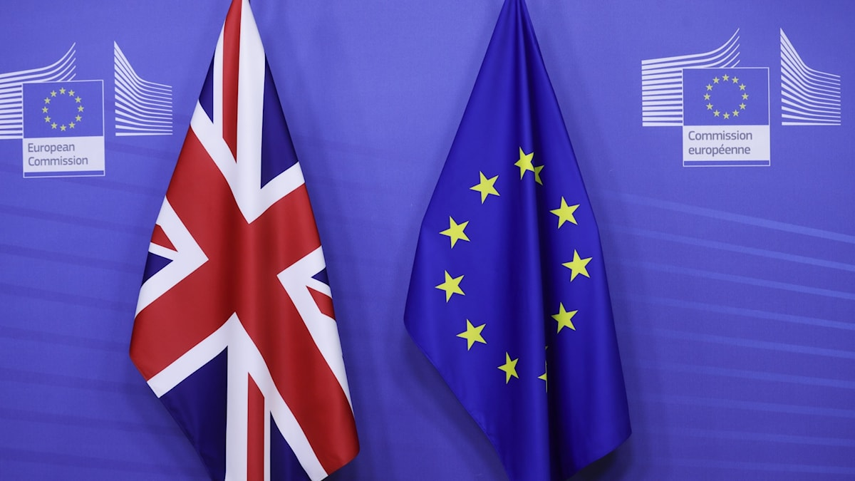 The UK flag and EU flag.