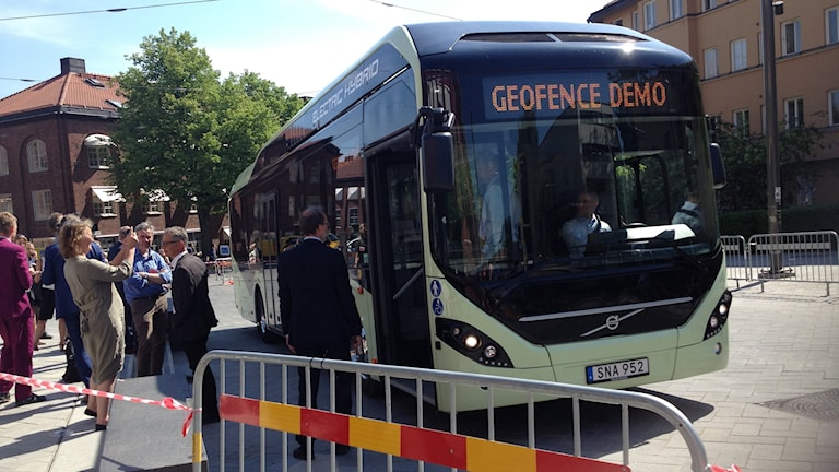 "A bus behind a fence. The headline on the bus says ""geofence demo"""